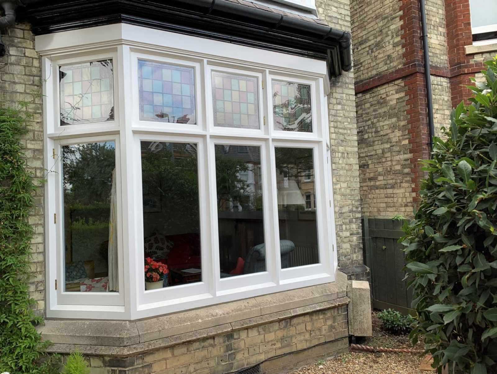 Casement bay window with encapsulated stained glass
